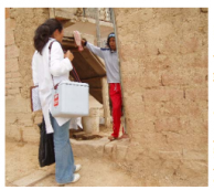 A health worker makes a home visit to vaccinate children in Sucre, Bolivia. ACPalomino, Courtesy of Photoshare, 2005.